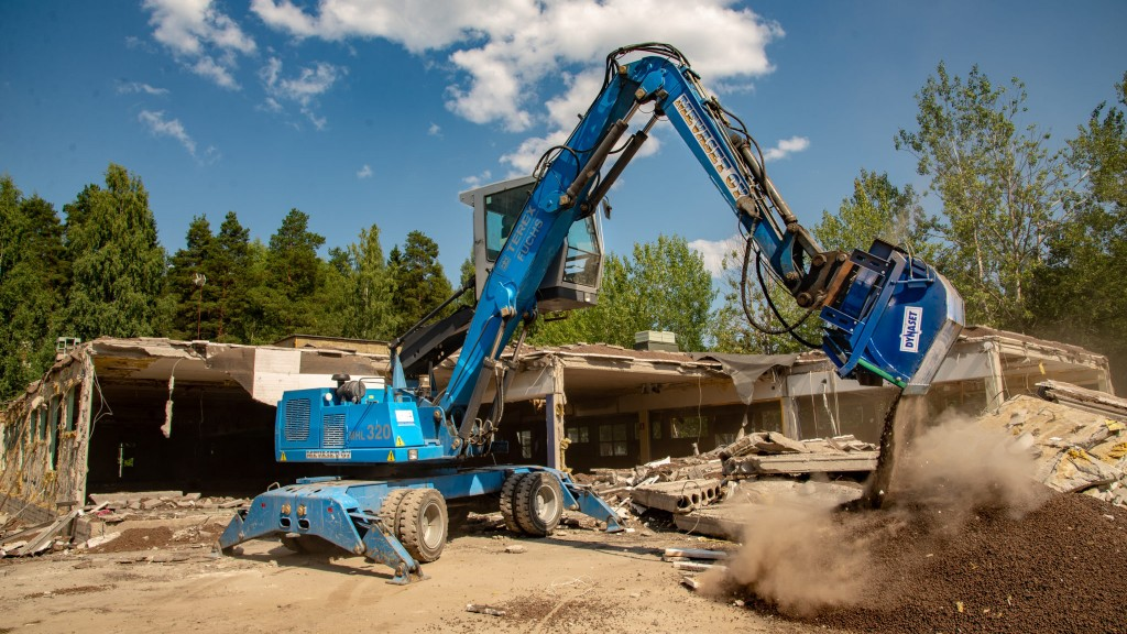 Dynaset's hydraulic recycling vacuum bucket attachment helps demolition companies save on waste fees