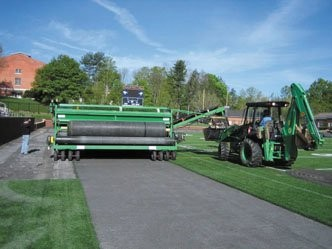 FieldTurf's Green Machine that is used to remove rolls of artificial turf and the infill