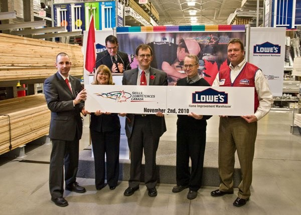 From left to right: Marc-Olivier Bélanger (Team Canada 2009 Welding Competitor), The Honourable Diane Ablonczy (Minister of State (Seniors), Donovan Elliott (President, Skills/Compétences Canada), Chuck Deighton (Teacher, Lester B. Pearson H.S.) and Alan Huggins (President, Lowe's Canada).