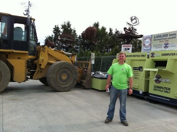 Matt Zubick in front of his eZcycle bins, at John Zubick Ltd, London, Ontario.