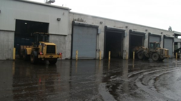 The Comox Valley Regional District's Biosolids Composting Facility uses five enclosed, aerated bays in the initial phase of treating the area's wastewater plant solid residuals.