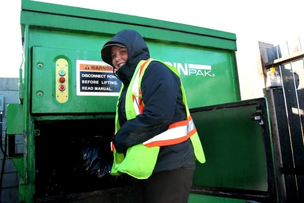 On a cold day in Ontario, Jennifer Davey finds taking the garbage out to be a much easier task using the Binpak compaction bin.