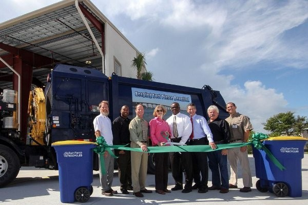 City of Fort Pierce Mayor Linda Hudson cuts the Grand Opening ribbon to celebrate Waste Management's Fort Pierce Transfer Station with Doug Davis, Richard K. Davis Construction; City of Fort Pierce Deputy City Manager Nick Mimms; Waste Management Government Affairs Director Jeff Sabin; Hudson; Florida State Representative Larry Lee; Commissioner Tom Perona; Okeechobee County Commissioner Bryant Culpepper; and Waste Management Operations Director Bryan Tindell.   Photo by Mitch Kloorfain