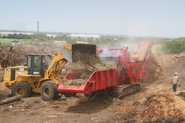 Rotochopper's FP 66 horizontal grinder on tracks on site at Austin Landscape Supplies.