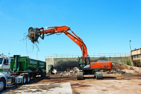 Standard Industries, at its core a scrap recycling company, sends their fleet of Hitachi excavators to work on demolition projects - an excellent source of scrap.