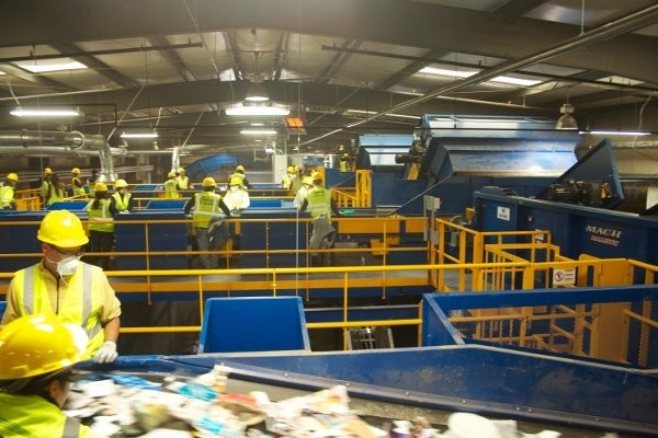 Inside the American Disposal facility at Manassas. Machinex 30-tons-per-hour single stream system includes an OCC Screen, Scalping Screen, Two Mach News Screen, MACH Ballistic separator, magnet, eddy current, plastics optical Sorters, single and 2-ram balers.