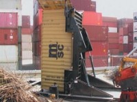 Container Tilter picks up and angles containers to 90 degrees
