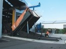 Container tilter picks up and angles to 90 degrees