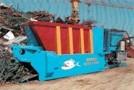 Scrap shear designed for economical processing