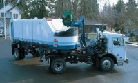 Automated side loader for semi-trailers updated