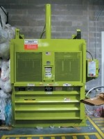 Environmentally-friendly vertical balers and compactors
