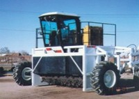 Straddle type windrow turners
