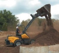 Utility loader features capacities comparable to skid steers