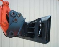 Skid-steer attachment system for excavators and backhoes