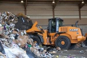 Waste handling loaders