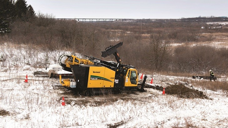 Vermeer's D100x140 Navigator horizontal directional drill successfully navigated the stone and cobble beneath the Little Saskatchewan River.