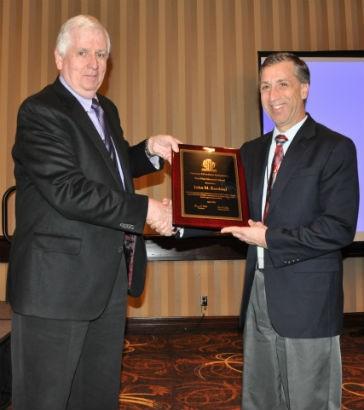 John Kurdziel, P.E. (right) of ADS receives the Paul Finn Memorial Award from  Tom Walsh, Chairman of ASTM-F17