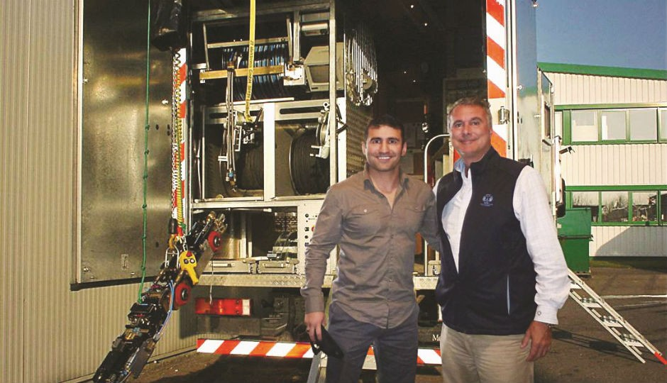 Jack Conie, president of Ca-Botics (right) and Afshin Hamed, vice president of STAR Canada, in front of the STAR remote-controlled robot system.