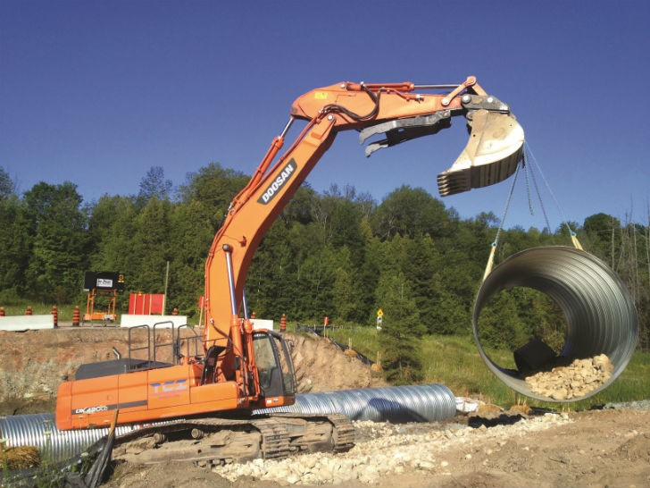 Titanium Contracting uses a Doosan DX235LCR and a DX420LC-3 (pictured) excavator to complete a variety of difficult municipal projects, including culvert repair and replacement.