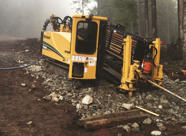 Trenchless Drilling Services deployed a Vermeer D36x50DR Series II NAVIGATOR horizontal directional drill using a 6-inch TCI Tricone drill head for a sewer line project in Coquitlam, B.C.
