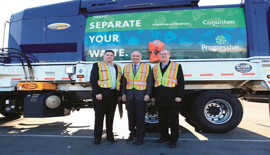 Left to right: Grant Hankins of Progressive Waste Solutions, Mayor Richard Stewart of Coquitlam, and Councillor Brent Asmundson of Coquitlam. Below: Mayor Stewart at the fuelling site.
