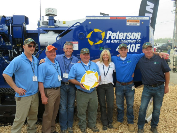 Tom Barry of Barry Equipment proudly accepts the Peterson 2014 Dealer of the Year award. L to R: Randy Earle, Mike Conway, Charlie Bagnall (Peterson), Tom Barry, Trish Barry, Joseph Barry, and Bryan Morris.