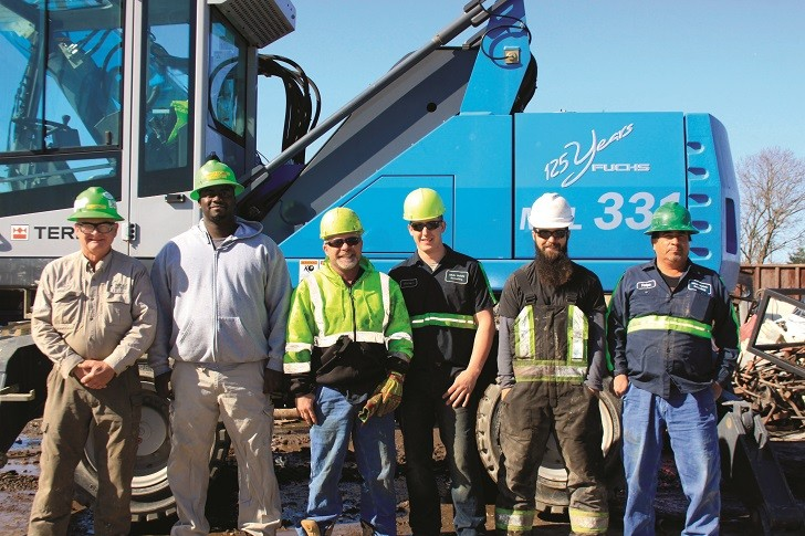 From left: In front of their new MHL331 material handler; Hugh Grandstaff, founder of hlh&r Metals Recycling, along with Chad Smith, Billy Hunter, Mike Shows, Jesse Hill and Felipe Lopez.