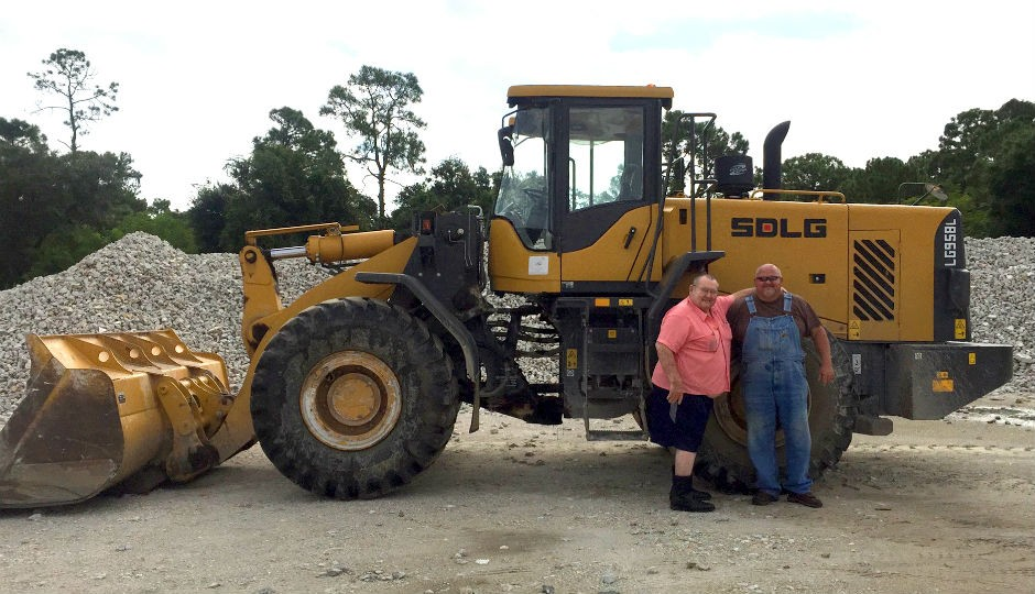 James Whitehead and Joe Johns of Whitehead and Johns show off the Floridian company's SDLG LG959L.