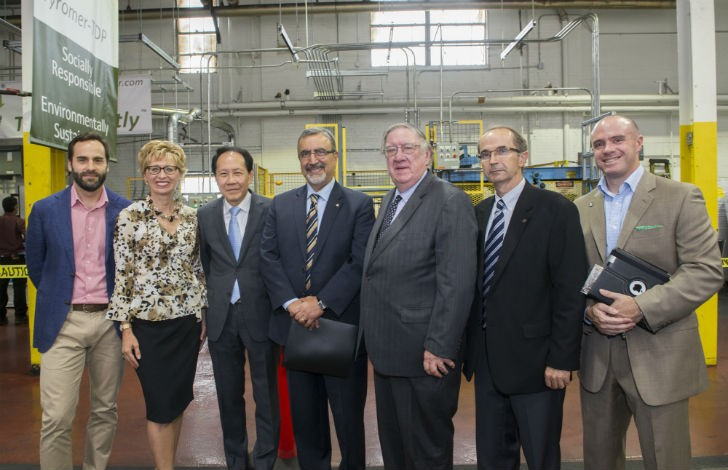 """""""Dignitaries at Tyromer Open House pose in front of the facility (CNW Group/Ontario Tire Stewardship)""""."""