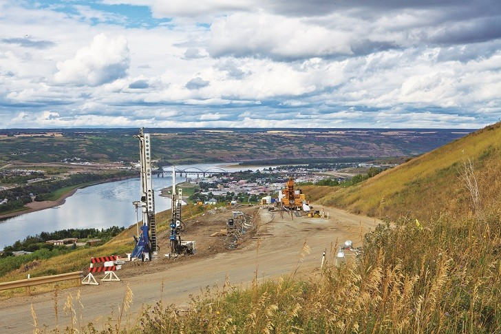 Doublestar Drilling worked to rescue Highway 744, which is perched on a sloping hillside and active landslide area overlooking Peace River Valley in Alberta. (Photo courtesy of Doublestar Drilling)