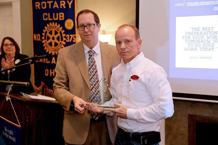Rick Szabrak presenting Business Ethics Award to Brad Hutchinson, owner of Company Wrench