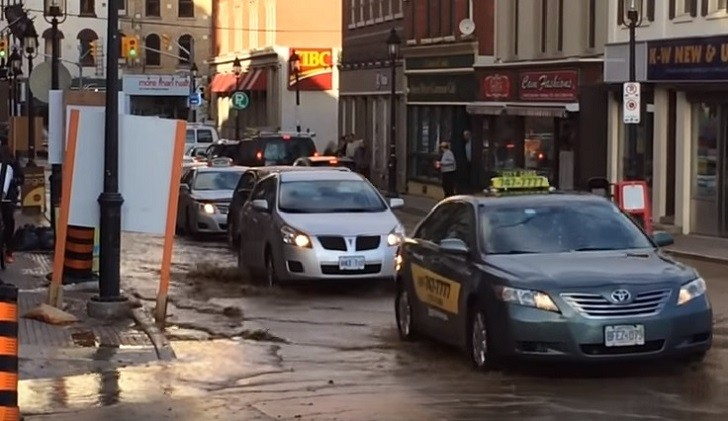 Water main break at  Charles and Queen Streets, in Kitchener, November 6, 2015.