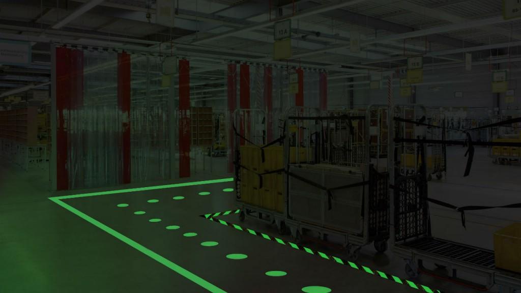 Anti-skid dots in dark warehouse.