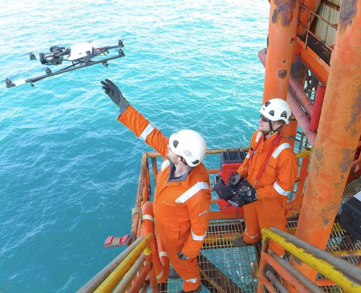 Offshore man with drone.