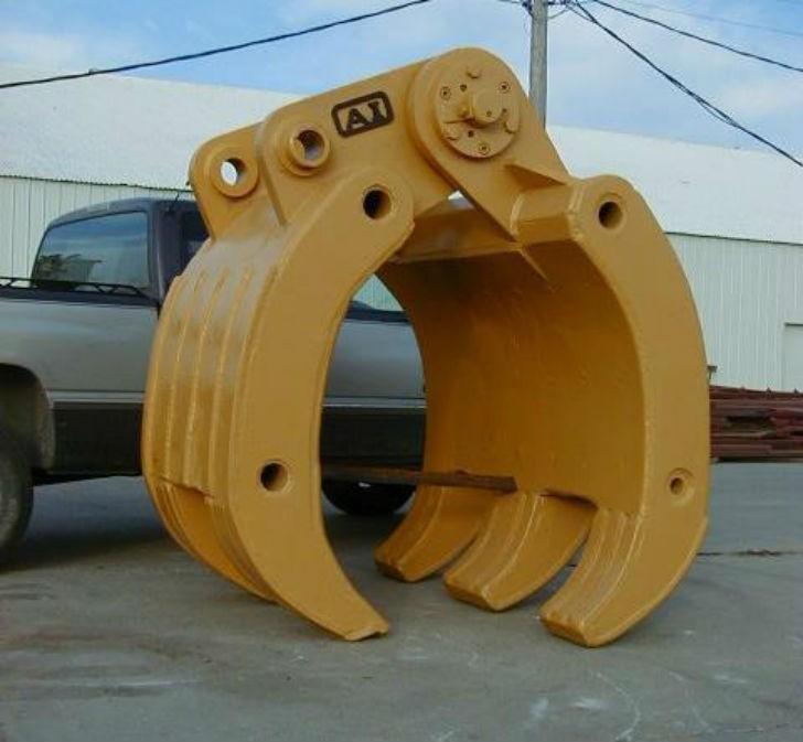 Designed for land clearing, raking, stacking, rehandling scrap, demolished and loose material.