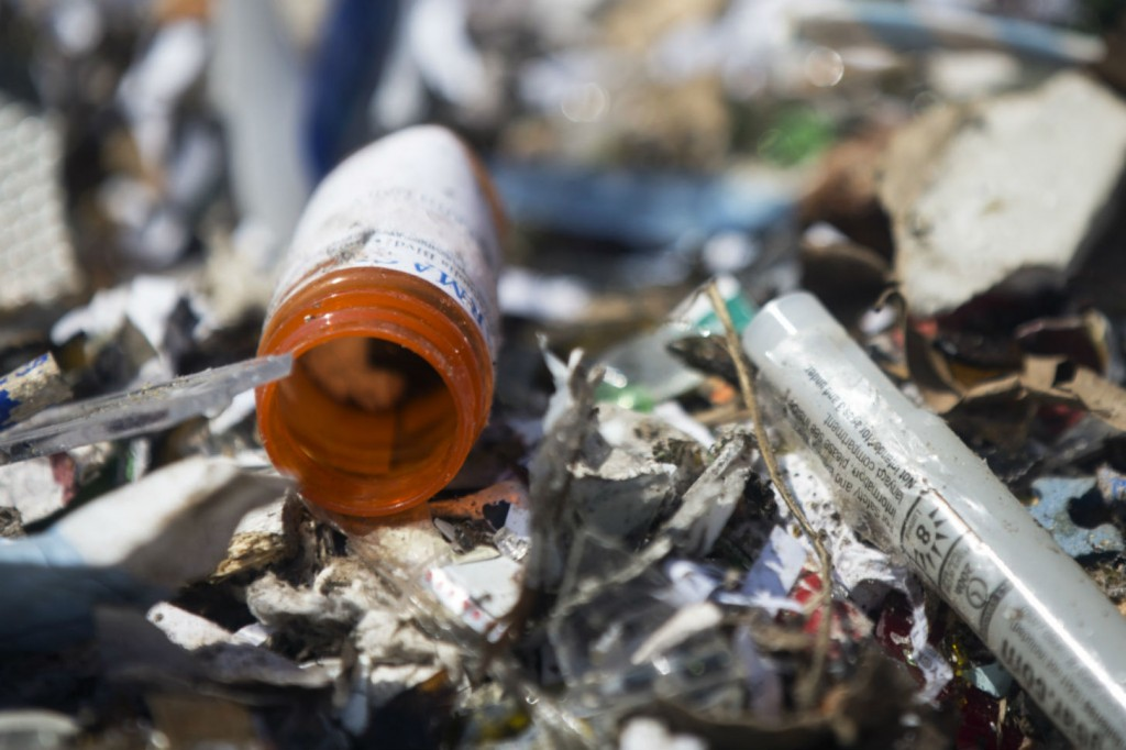 A prescription drug bottle sits inside a bin of recyclables at the Burbank Recycling Center. The Los Angeles County Board of Supervisors is considering an ordinance that would make drug and sharps manufacturers develop and pay for a program to collect and dispose of their unused products.