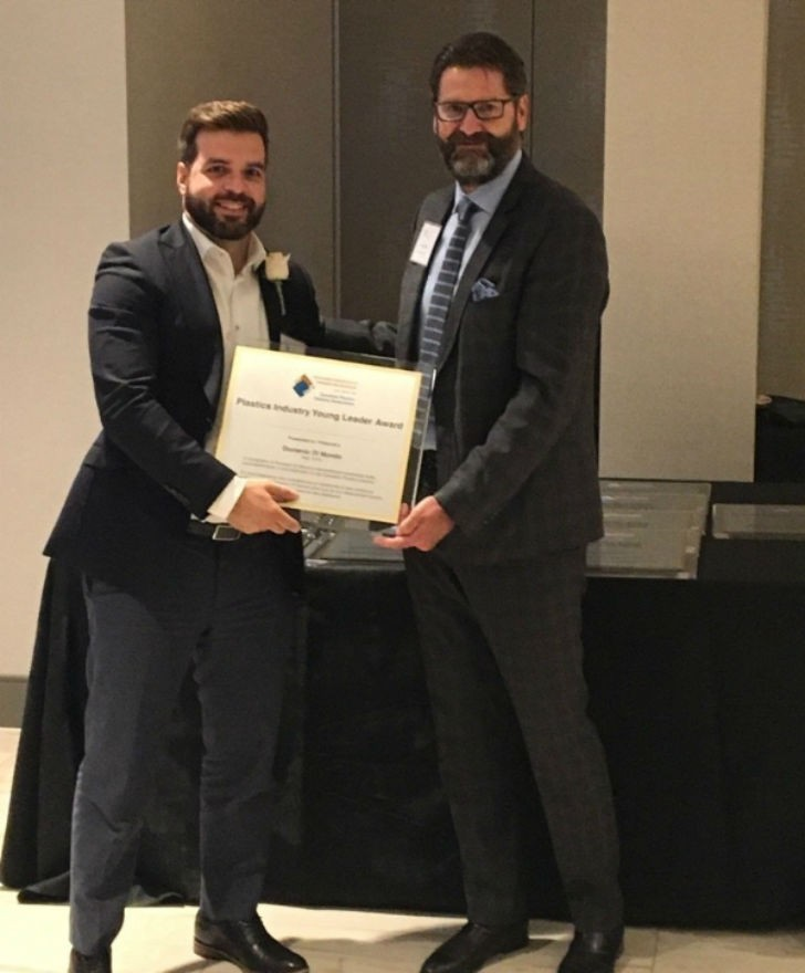 """Domenic di Mondo (left) receives the """"Young Leader Award"""" at the Plastics Industry Leadership Awards Dinner."""