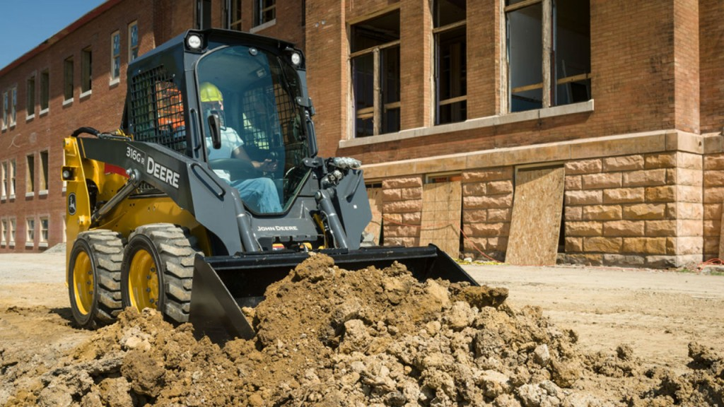 316GR skid steer with grading heel bucket.
