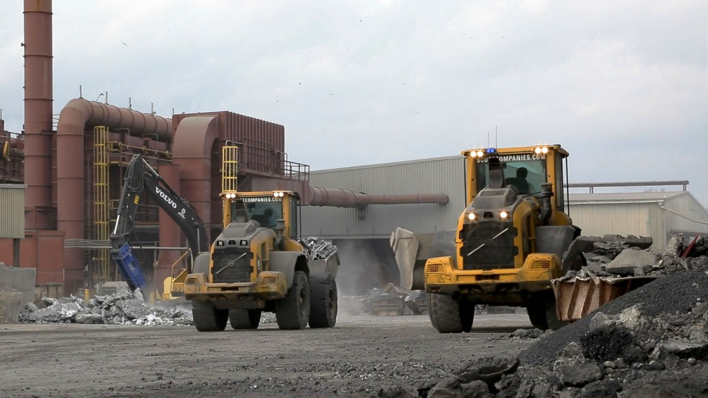 Two Volvo L70H wheel loaders move raw material onsite.