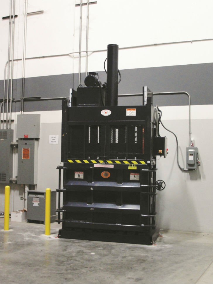 EPAX Systems' DX60-8 downstroke vertical baler. Downstroke balers from EPAX provide bale sizes from 42 to 72 inches, bale weights up to 1,600 pounds, and feature large feed openings and an innovative safety system.
