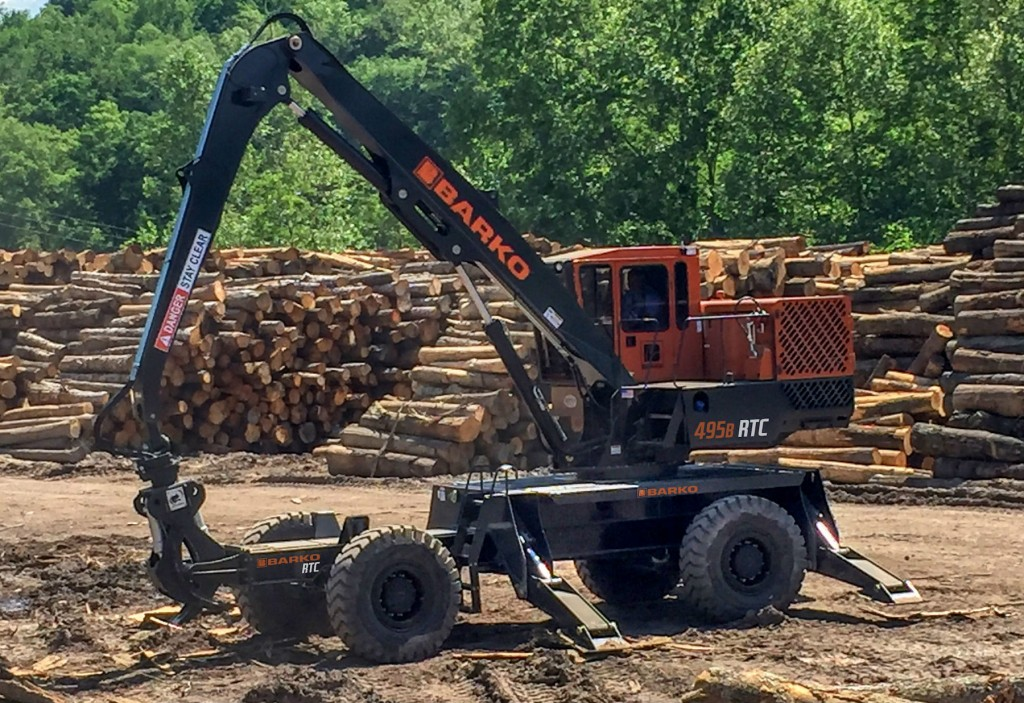 Log loader handles rough terrain with more power and maneuverability