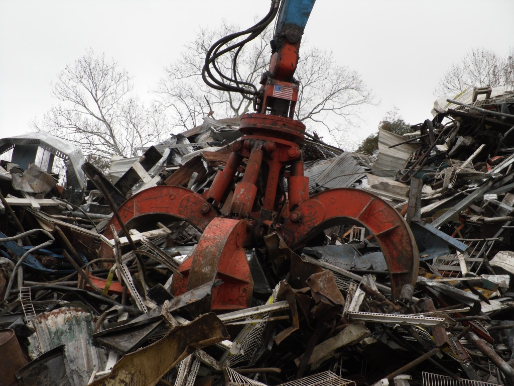 """With their new Mack grapple and dedicated material handler, ASM can efficiently pick and sort ferrous metals, providing the """"right metal recipes"""" for the nearby SSAB Americas steel mill."""