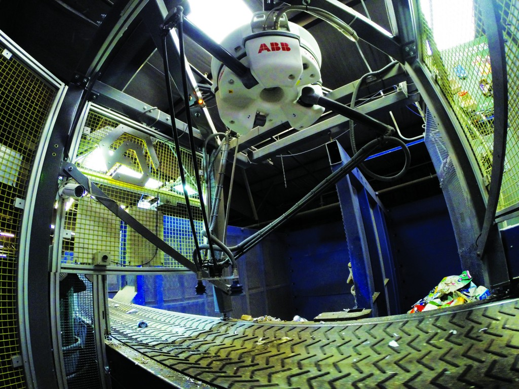 The Cortex (aka Clarke) is a robotic unit developed by AMP, using optical scanning and specialized grippers that allow it to differentiate and pick up material from moving belts