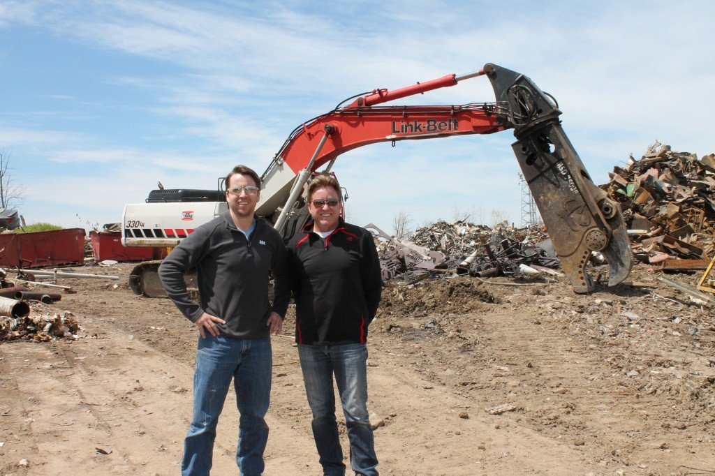 Doug and Lawry Slipacoff of Trijan Industries, in front of their Link-Belt excavator with LaBounty mobile shear, used for handling all oversized steel cutting.