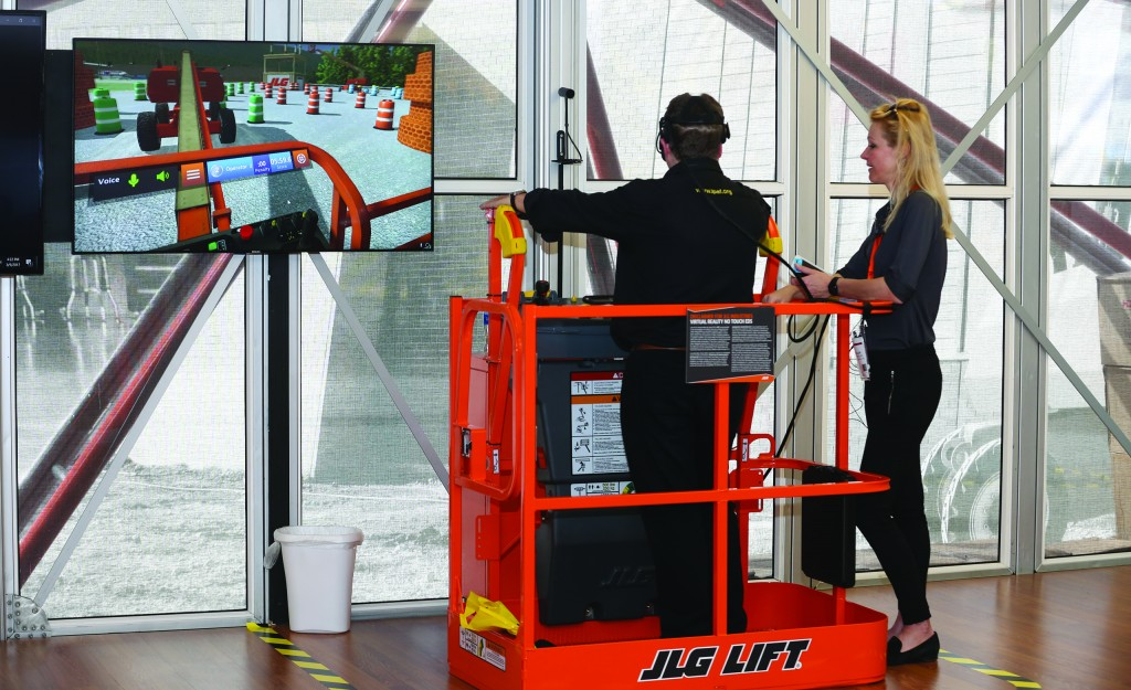 CONEXPO show attendee tests out JLG's Training Simulator.