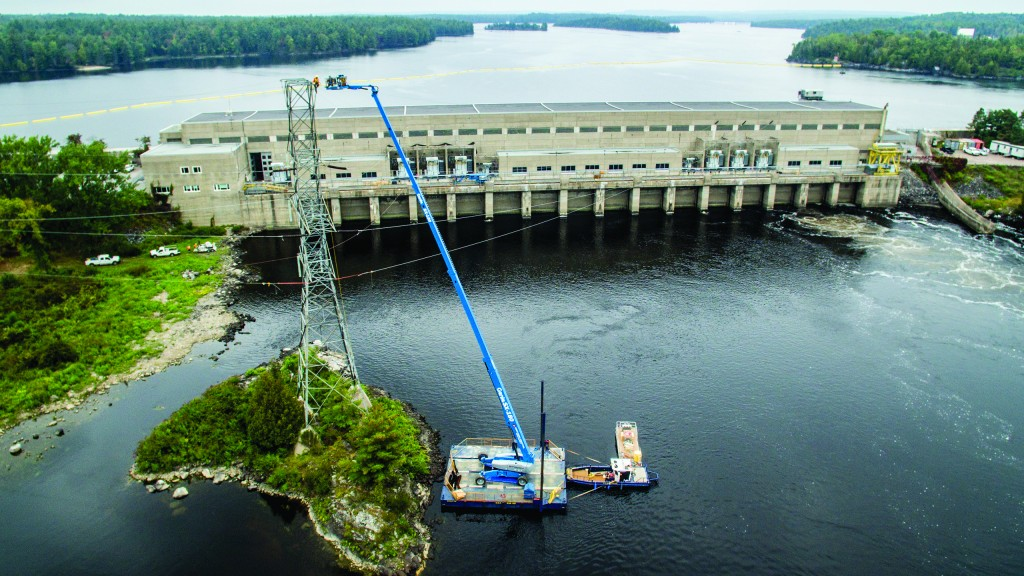 The Genie SX-180 telescopic boom was operated from a barge for a tricky line replacement at the Chenaux Generating Station on the Ottawa River.