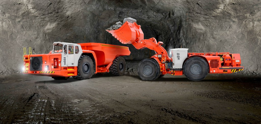 Sandvik's LH517 underground loader (right) loads material into a Sandvik TH551 truck; the Sandvik LH517 is equipped with an EU Stage V engine solution from Volvo Penta.