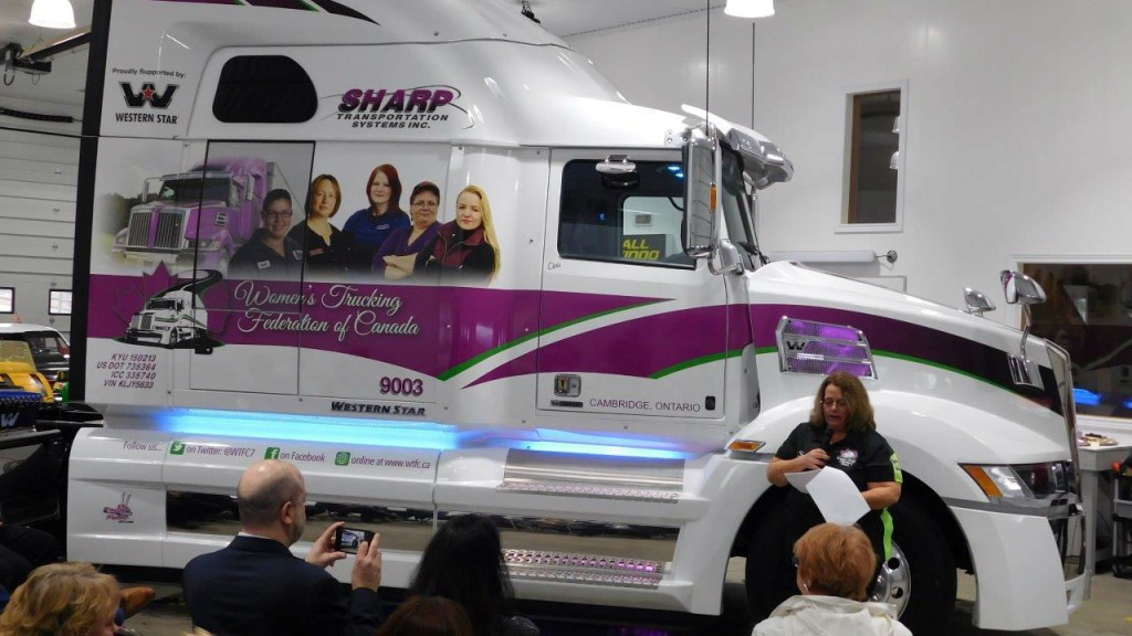 Shelley Uvanille-Hesch addresses the audience at the unveiling of the wrapped Western Star 5700XE.