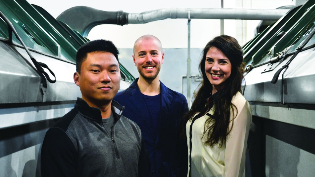 The Hop Compost executive team between two HotRot vessels. From left to right: Chris Wong, CTO; Kevin Davies, Founder & CEO; and Meghan Perry, CFO.