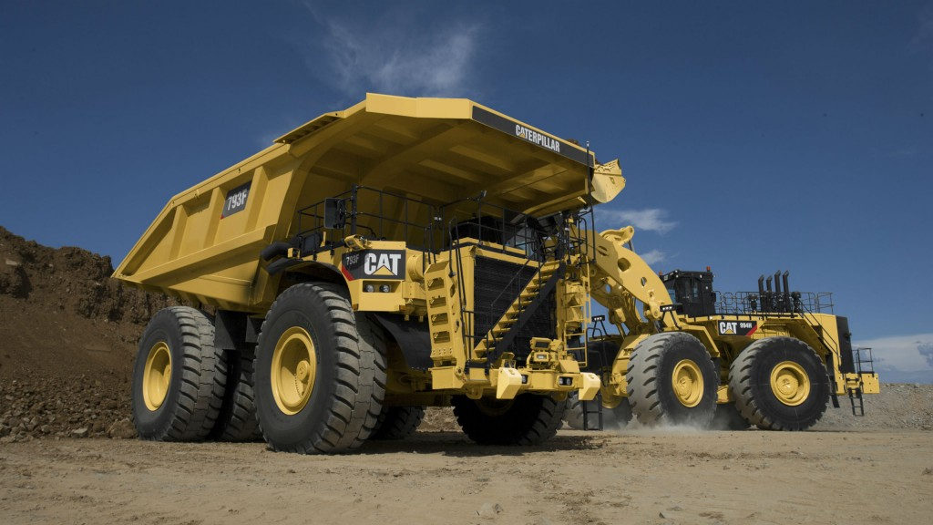 A Cat 793 being loaded by a Cat loader at a mine site.